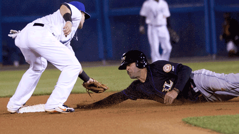 Ryan Adams tags out Mike Costanzo during a 7th inning steal attempt